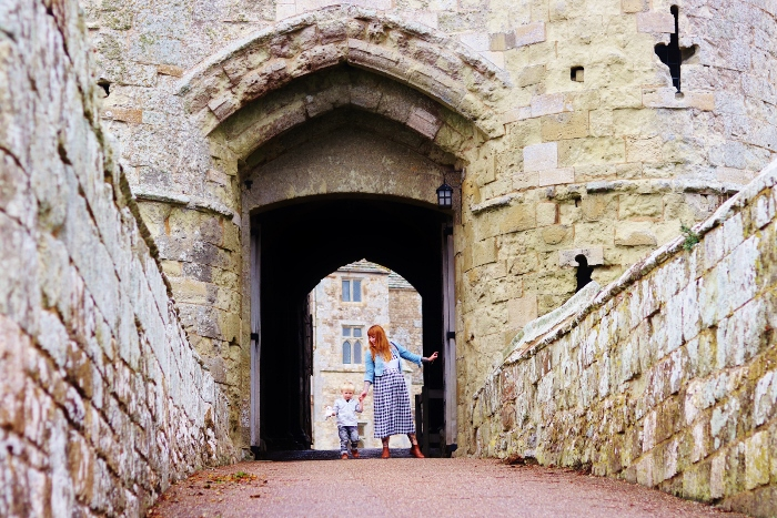 Family exploring Carrisbrooke Castle